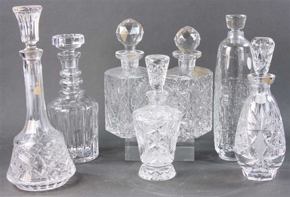 Seven Blown and Cut Glass Decanters