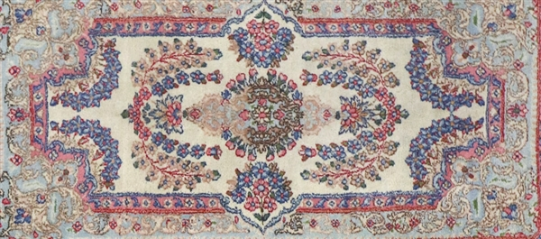 Two Antique Persian Kerman Rugs