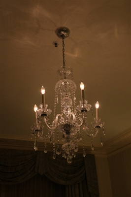 Waterford style crystal chandelier with assorted prisms and swag design