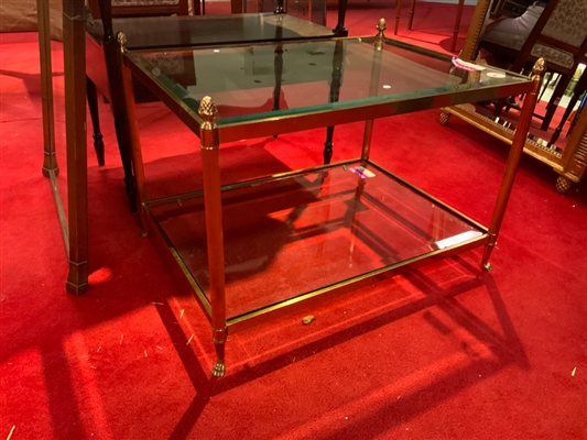 Brass and glass end table together with a pair of brass and glass lamps