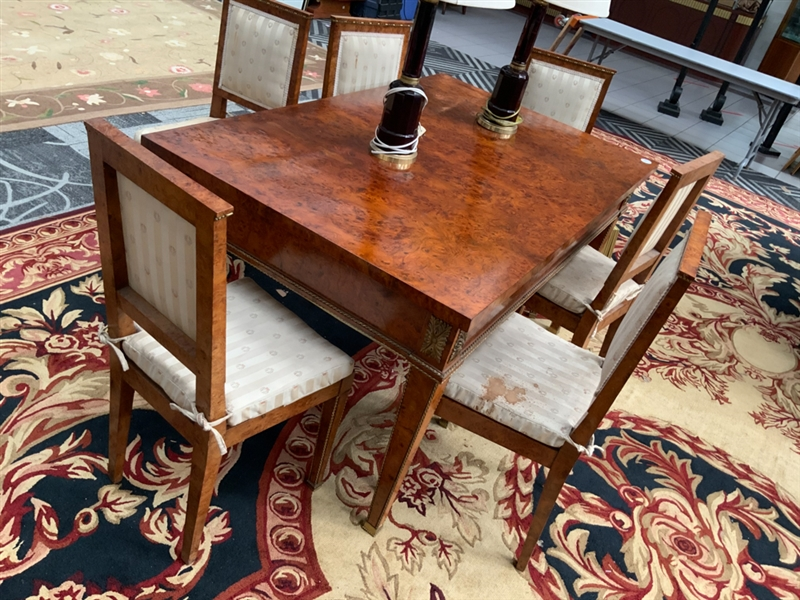 French burlwood table with inlay and mounts, together with 6 chairs