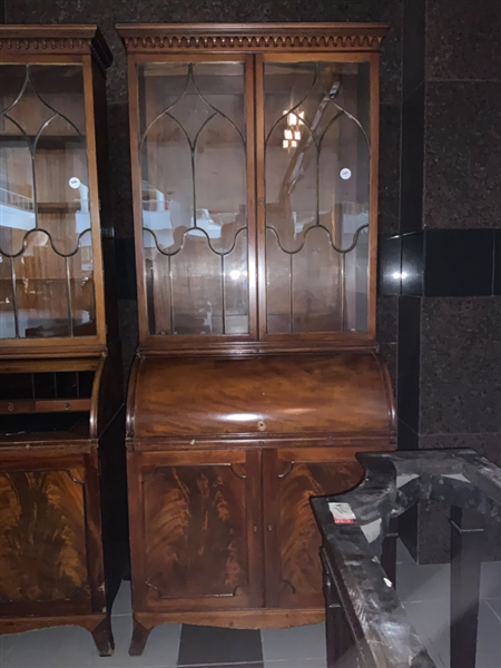 Secretary with glass cabinets and cylinder desk