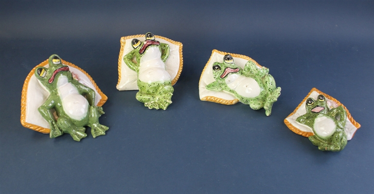 Ceramic Frogs on Pillows
